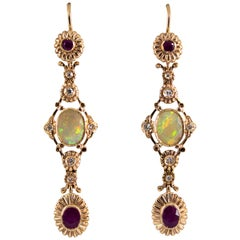 1.40 Carat Opal 1.30 Carat Ruby White Diamond Yellow Gold Drop Earrings