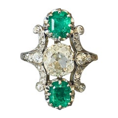 1.40 Carats Emeralds and 1.10 Carat Diamonds French Antique Ring