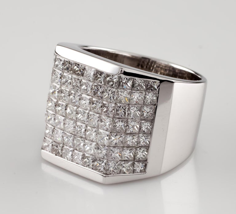 Large 18k White Gold Diamond Plaque Ring Features Beveled Plaque of Invisible-Set Princess Cut Diamonds Dimensions of Plaque = 18 mm Long Center Section = 15 mm Wide, Wing Sections = 7.5 mm Wide Total Diamonds Weight: Approximately 14