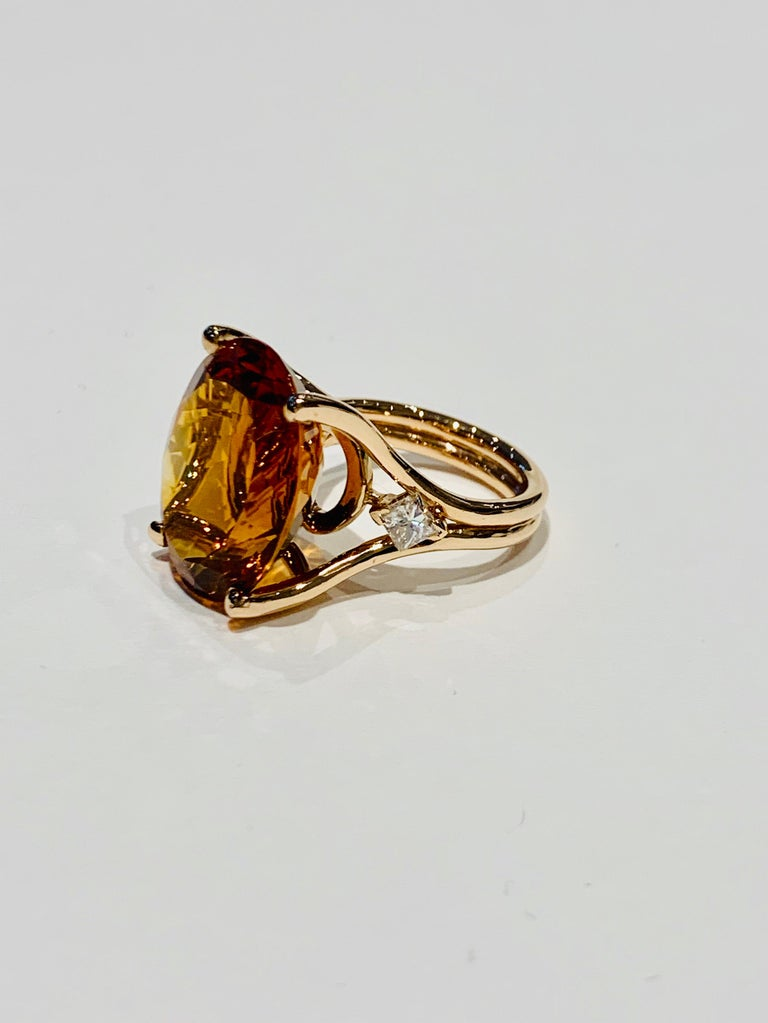 A stunning 14ct deep Madeira Citrine* oval stone has been set in 18ct Rose Gold with two amazing 0.25 ct Princess Cut diamonds as accents.  The design was made using a CAD to make sure we had the best design for this stone.  The Citrine measures 20