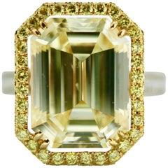 14.10 Carat Fancy Light Yellow Emerald Cut Diamond And White Diamond Ring In 18K
