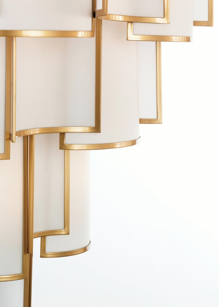 SHADE Collection - A composition of small curved framed panels that create a luminous movement, also available in other finishes & fabrics, as well as sizes. All Officina Luce items are customizable.  Main structure in natural brass in satin gold