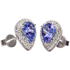 1.42 Carat Pear Shaped Tanzanite 0.30 Carat White Diamond 18 Karat Gold Earrings
