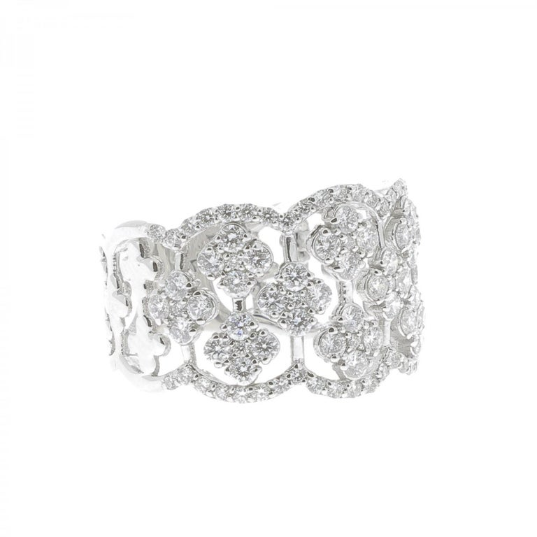 The Clover Ring is a unique and trendy ring set with 1.42 carat. The ring is paved with clover set with brilliants cut diamonds. The Ring is in 18K White Gold. The Diamonds are GVS quality. The ring size is 6 ½ US and can be size.