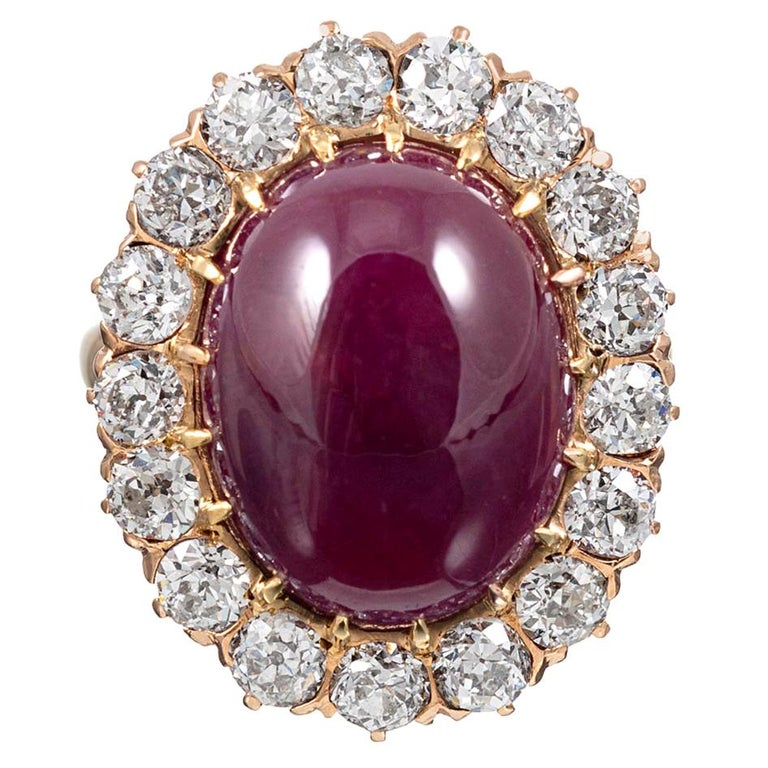 14.20 Carat Cabochon Ruby and Diamond Cluster Ring For Sale