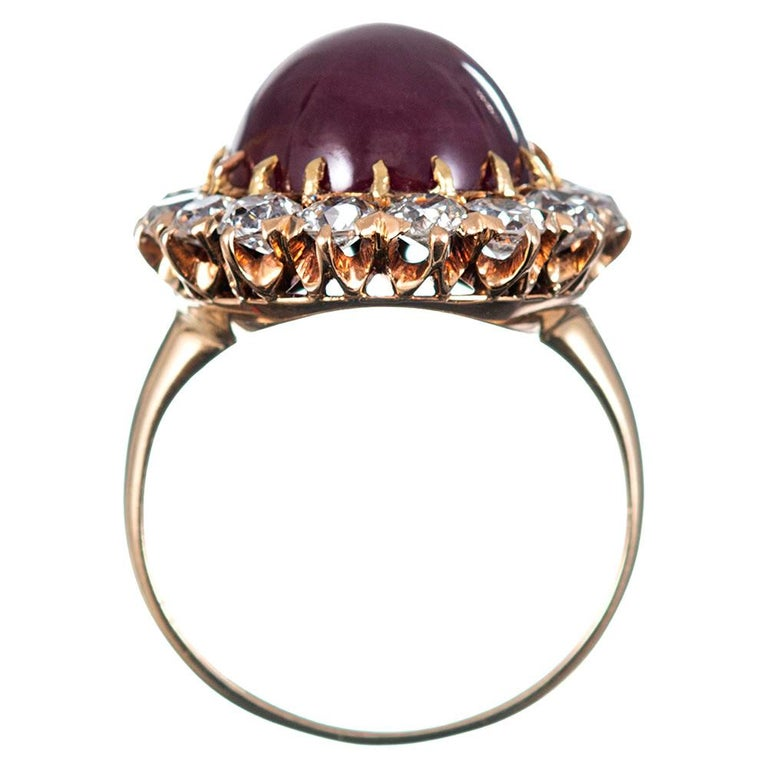 Women's or Men's 14.20 Carat Cabochon Ruby and Diamond Cluster Ring For Sale