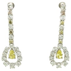 1.43 Carat GIA Certified Fancy Intense Yellow Diamonds and Diamond Gold Earrings