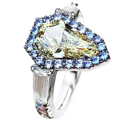 1.43 Carat VVS2 GIA Fancy Yellow Shield Cut Diamond, Unheated Blue Sapphire Ring