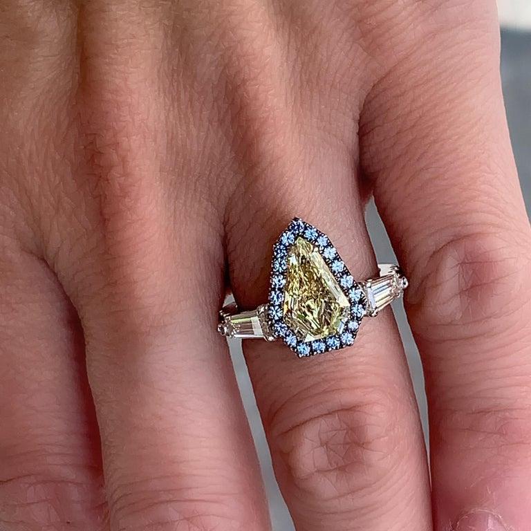 1.43 Ct. VVS2 GIA Fancy Yellow Shield Cut Diamond, Unheated Blue Sapphire Ring For Sale 4