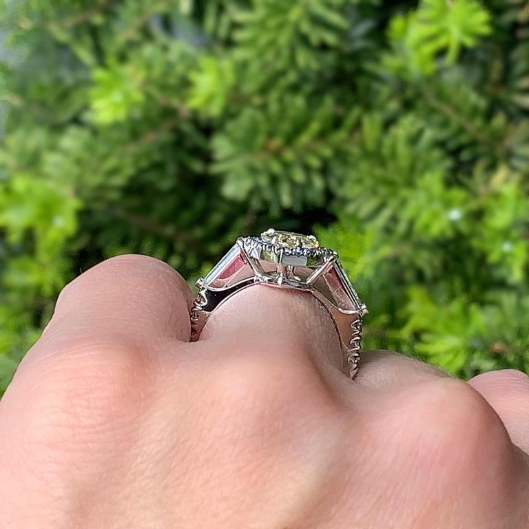 1.43 Ct. VVS2 GIA Fancy Yellow Shield Cut Diamond, Unheated Blue Sapphire Ring For Sale 6