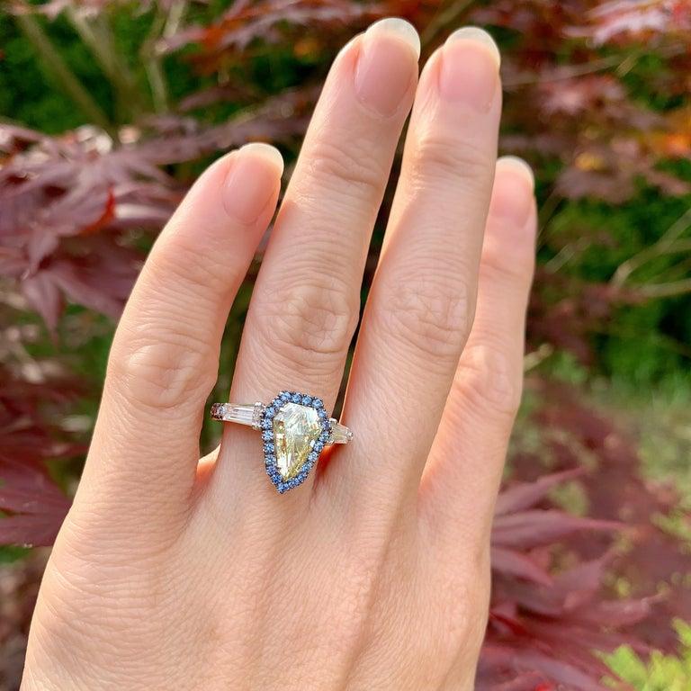 1.43 Ct. VVS2 GIA Fancy Yellow Shield Cut Diamond, Unheated Blue Sapphire Ring For Sale 7