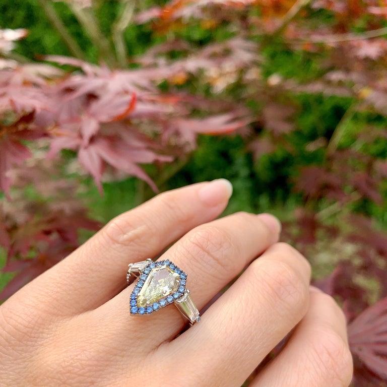 1.43 Ct. VVS2 GIA Fancy Yellow Shield Cut Diamond, Unheated Blue Sapphire Ring For Sale 8