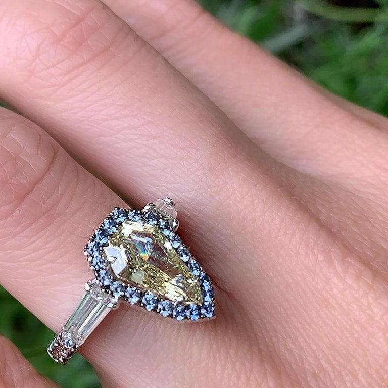 1.43 Ct. VVS2 GIA Fancy Yellow Shield Cut Diamond, Unheated Blue Sapphire Ring For Sale 9