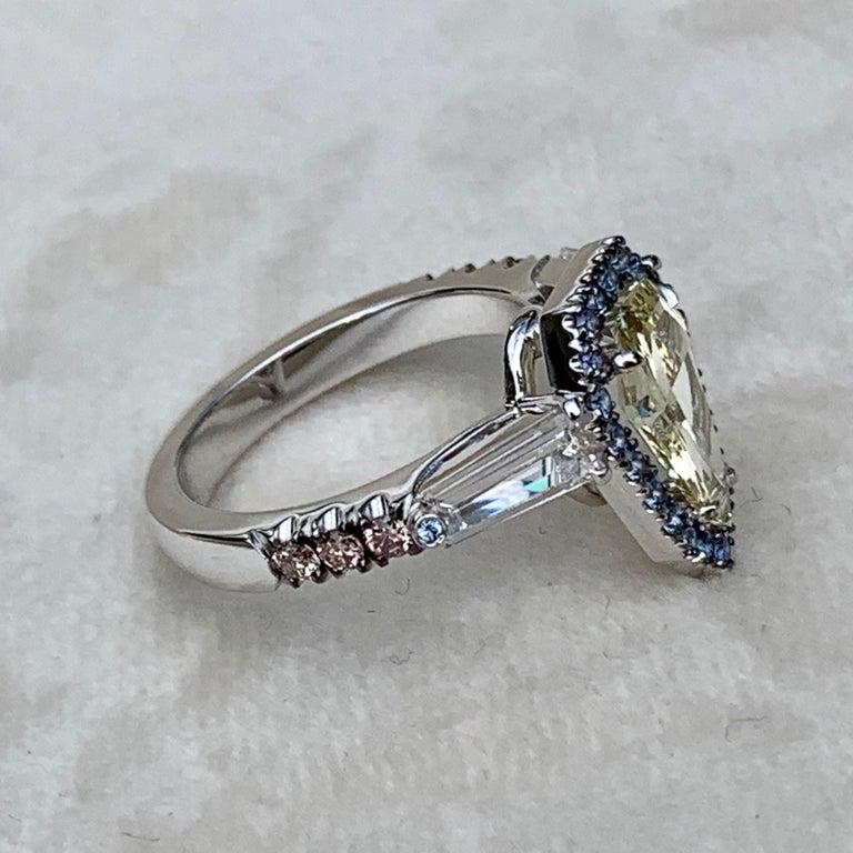 1.43 Ct. VVS2 GIA Fancy Yellow Shield Cut Diamond, Unheated Blue Sapphire Ring For Sale 2