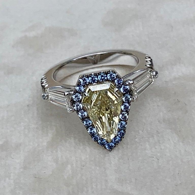 1.43 Ct. VVS2 GIA Fancy Yellow Shield Cut Diamond, Unheated Blue Sapphire Ring For Sale 3