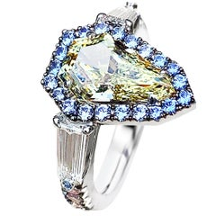 1.43 Ct. VVS2 GIA Fancy Yellow Shield Cut Diamond, Unheated Blue Sapphire Ring