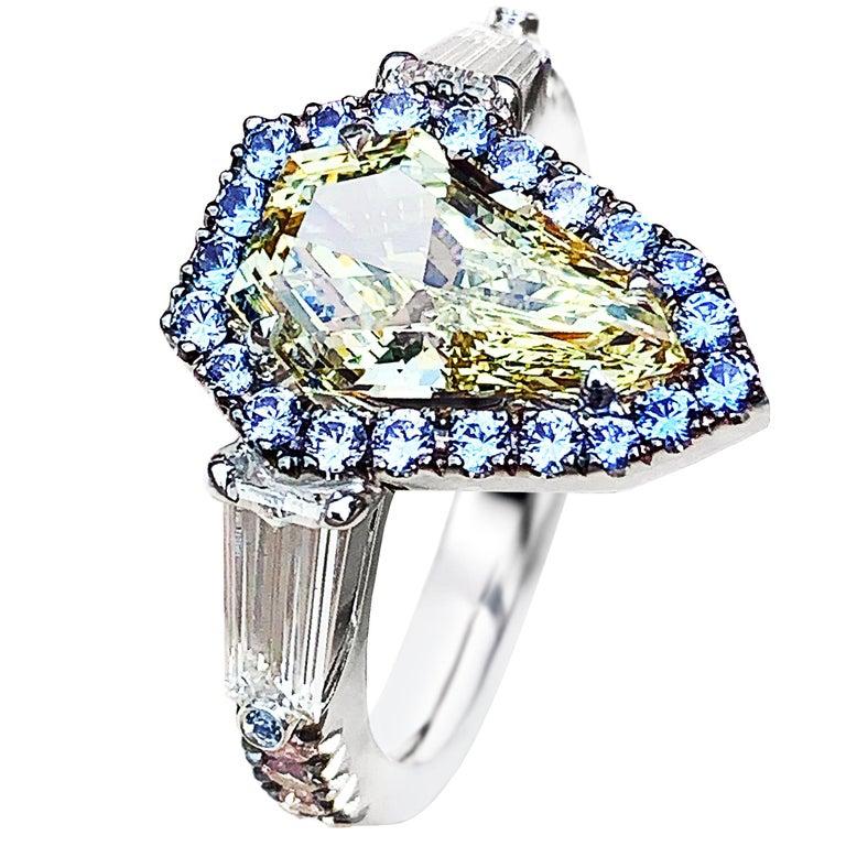 1.43 Ct. VVS2 GIA Fancy Yellow Shield Cut Diamond, Unheated Blue Sapphire Ring For Sale