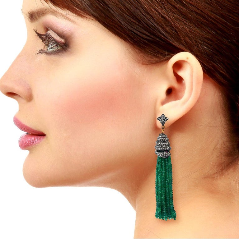 These stunning tassel snake earrings is handmade in 18-karat gold & sterling silver, 143.75 carats emerald and set with 6.35 carats of glittering diamonds.   Please note that carat weights may slightly vary as each Meghna Jewels creation is