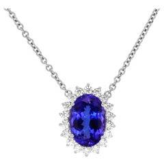 14.38 Carat Oval Tanzanite Diamond Halo Pendant Necklace 18 Karat White Gold