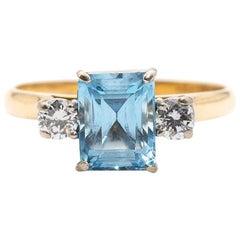 1.44 Carat Emerald Cut Aquamarine and Diamond 18 Carat Gold Three-Stone Ring
