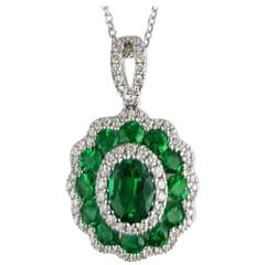 1.44 Carat Fine Emerald and White Diamond Flower Pendant in 18 Karat White Gold