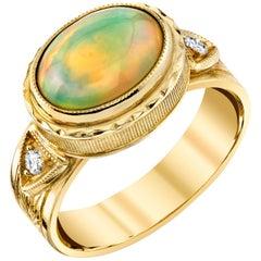 1.44 Carat Bezel Set Opal Cabochon & Diamonds 18 Karat Yellow Gold Ring