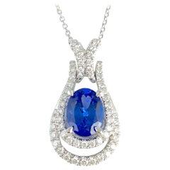 1.44 Carat Oval Cut Vivid Blue Tanzanite and Diamond Pendant