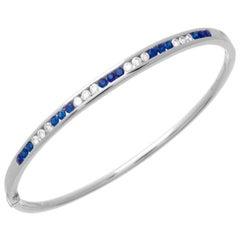 1.44 Carat Sapphire and Diamond Bangle 18 Karat White Gold