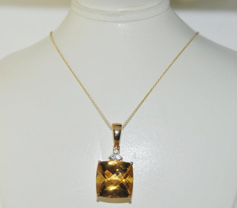 Pendant featuring 14.41 carat cushion checkerboard surface Citrine with 3 white Sapphires 0.23 carat in silver yellow plated.  Pendant length 1.25 inches, width 0.57 inches.
