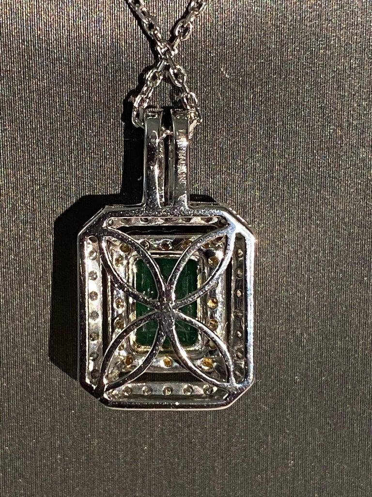 Artisan 1.45 Carat Emerald Cut Emerald Diamond Halo Pendant For Sale