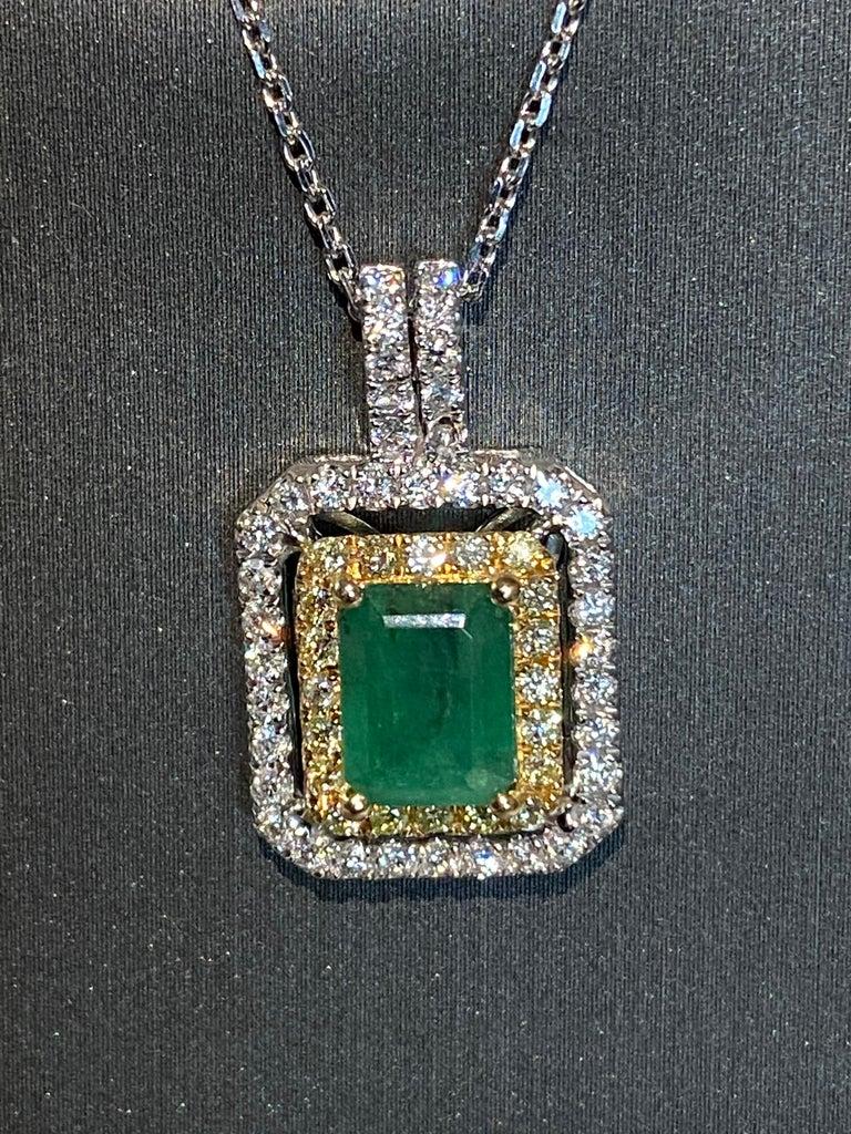 Women's 1.45 Carat Emerald Cut Emerald Diamond Halo Pendant For Sale