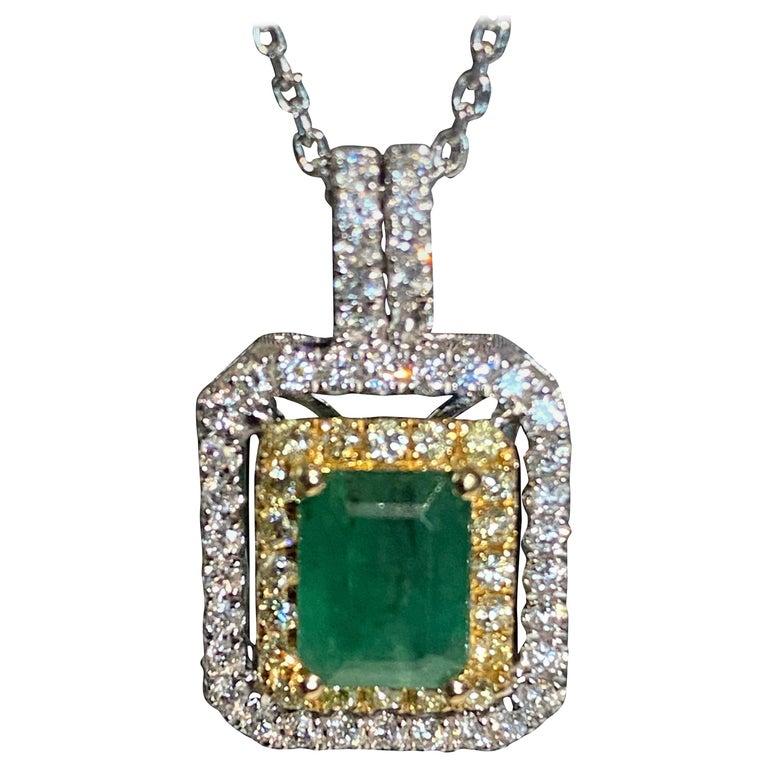 1.45 Carat Emerald Cut Emerald Diamond Halo Pendant For Sale