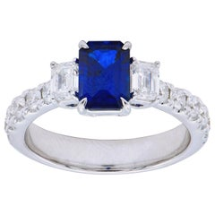 1.45 Carat Emerald Cut Sapphire Ring with Emerald Cut and Round Diamonds