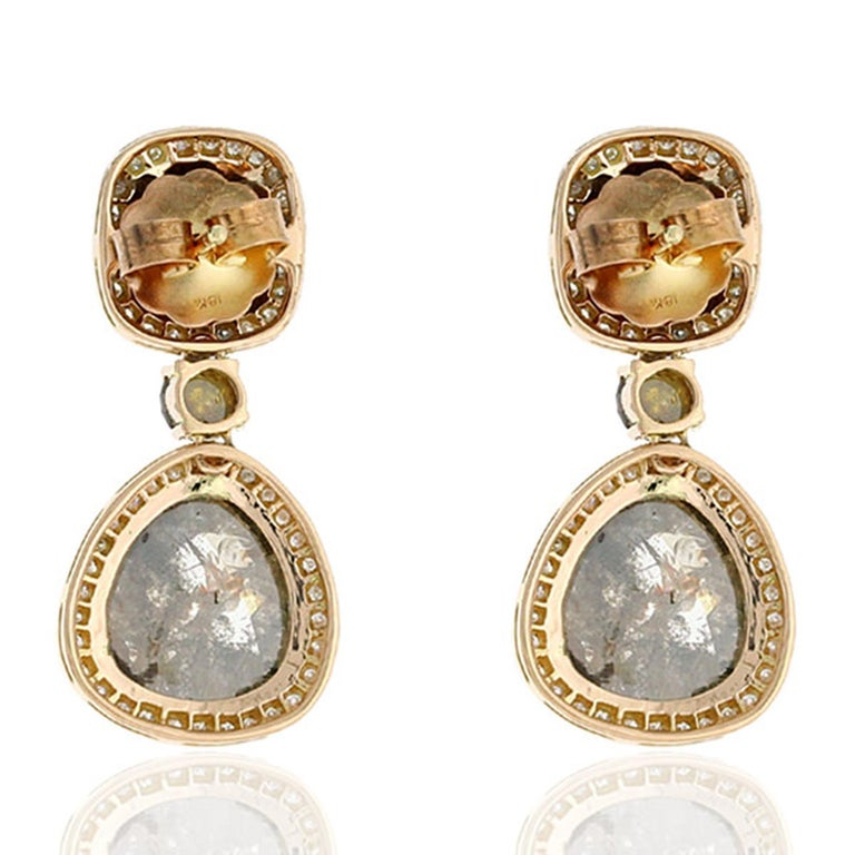 These stunning drop earrings features fancy grey natural diamonds and enhanced with brilliant cut diamonds. Handmade in 18-karat gold and 14.55 carats diamonds. One of a kind. Instock  Please note that carat weights may slightly vary as each Meghna