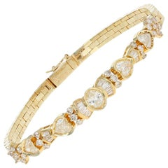 1.46 Carat Oval Cut Diamond Bracelet, 14 Karat Yellow Gold Hearts