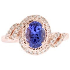 Oval Natural Tanzanite and Round White Diamond Halo Swirl Ring 14K Rose Gold