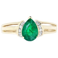1.46 Carat Pear Shaped Emerald and Diamond Triple Band Ring