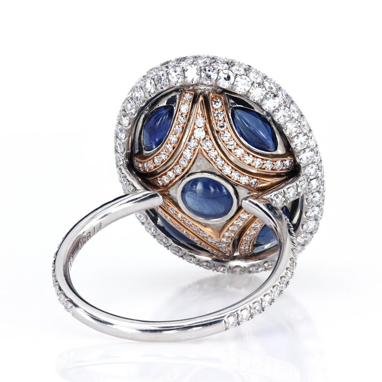 Extraordinary right-hand ring, featuring a Burmese blue moonstone set in an elaborate micro pave setting.  Moonstone is the official State Gem of Florida, named to commemorate the Moon landings since the space mission took off from Florida Cape