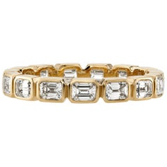 Emerald Cut Diamonds Set in a Handcrafted Channel Set Yellow Gold Eternity Band