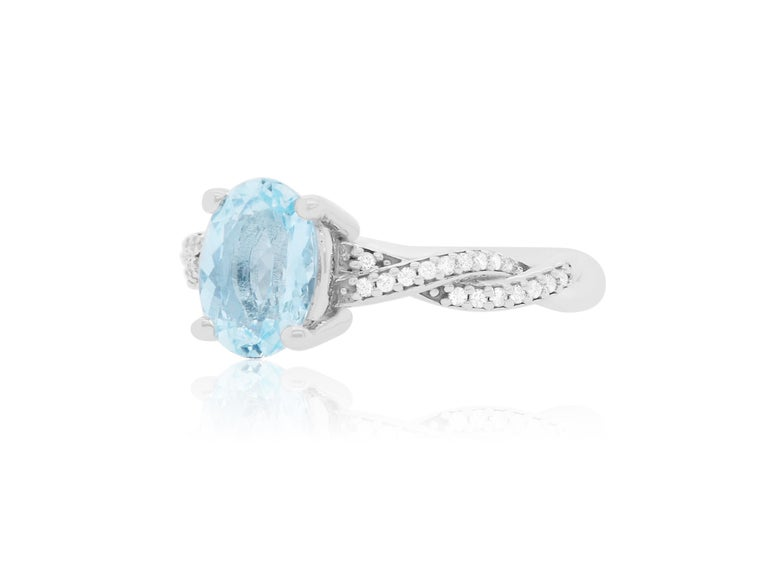 Material: 14k White Gold  Center Stone Details: 1.47 Carat Oval Shaped Aquamarine - Measuring 9 x 6 mm Diamond Details: 34 Brilliant Round White Diamonds at Approximately 0.13 Carats - Clarity: SI / Color: H-I Size 6.75. Complimentary sizing on all
