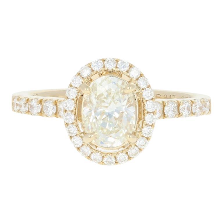 1.47 Carat Oval Cut Diamond Engagement Ring, 14 Karat Yellow Gold GIA Halo For Sale