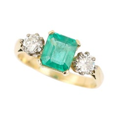 1.48 Carat Emerald and 0.60 Carat Diamond Three Stone Ring 18 Karat Yellow Gold