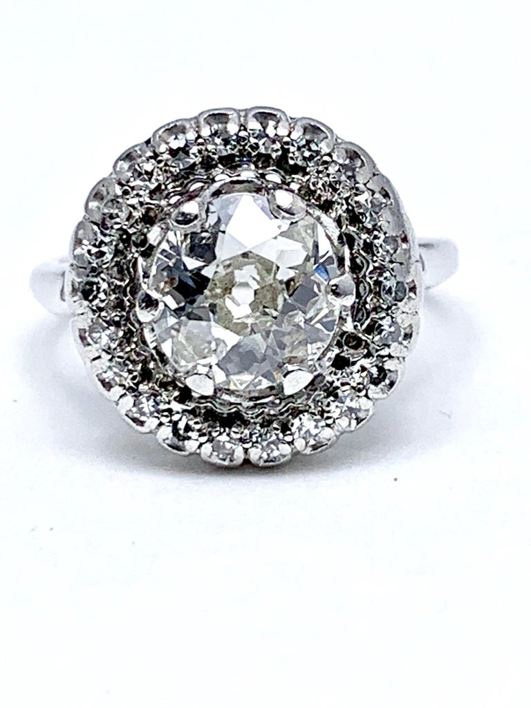 A gorgeous 1.48 carat old European cut and single cut Diamond engagement ring set in 18 karat white gold.  The old European cut Diamond is set with six prongs, surrounded by a single row of single cut Diamonds weighing 0.40 carats total.  The 1.48