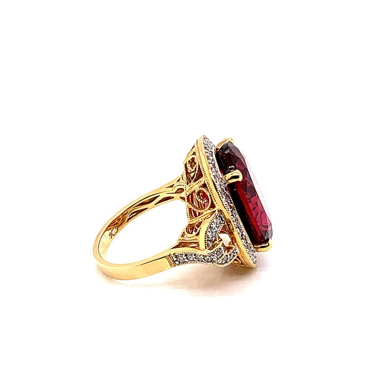 Oval Cut 14.95 Carat Oval Shaped Rubelite Ring in 18 Karat Yellow Gold with Diamonds For Sale