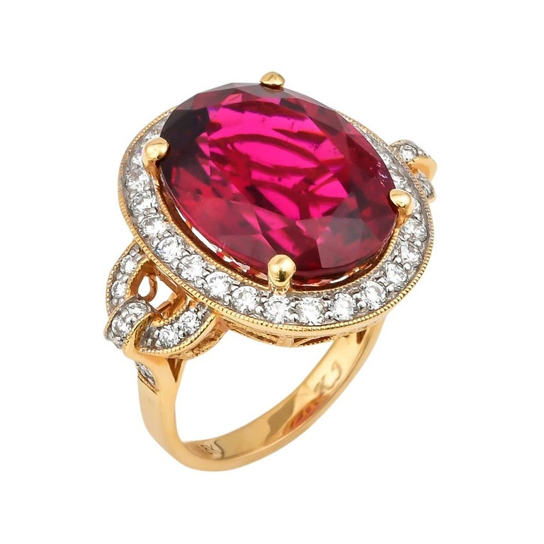 14.95 Carat Oval Shaped Rubelite Ring in 18 Karat Yellow Gold with Diamonds For Sale
