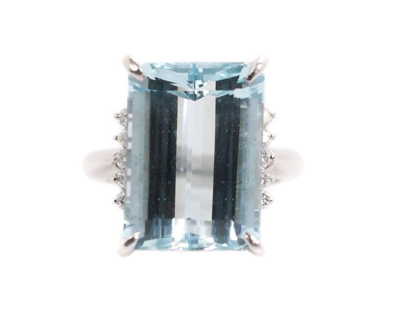 1950s 14.96 carat Aquamarine Ring - Platinum, Aquamarine, Diamonds  Features: 14.96 Emerald Step cut Aquamarine 10 Round Brilliant Diamonds Platinum Setting with Open Gallery 3.5 millimeter shank  Fits a size 6, can be resized Hallmarked 14.96