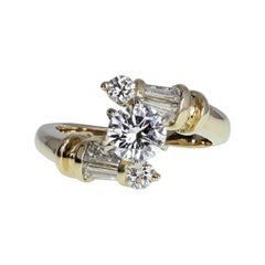 14 Carat Gold Diamond Solitaire Twist Engagement Ring