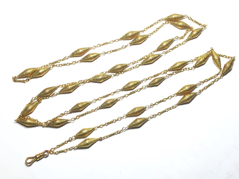 A 14ct gold long chain with twisted wire and conical rope links, with a lobster clasp, circa 1940-1950.  127cm long.