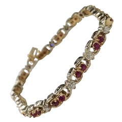 14k 2-Tone Gold Oval Ruby and Diamond Bracelet, Containing 25 Oval Rubies of Gem