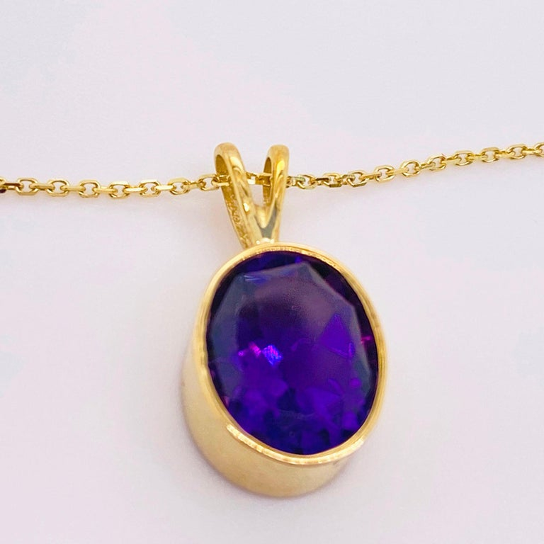 14 Karat Amethyst Necklace-Large 2.00 carat  On cable Chain with lobster clasp  Adjustable Lengths that can either be 18 or 16 inches long  Pendant is 10 mm by 9 mm oval with handmade bezel